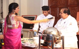 The host Laxmi Rebecca interacting with Chef Nimish Bhatia during Cook-a-thon