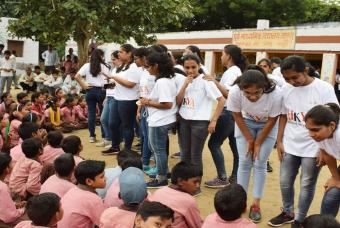 Volunteers interact with the excited children