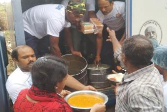 Fresh food being served to people affected by the flood