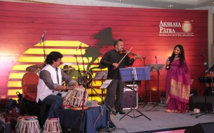 Ambika Jois, a versatile singer performing at the event along with her father Chandru Jois also known as Violin Chandru