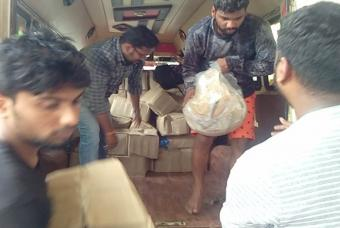 Food packets being unloaded in Kerala