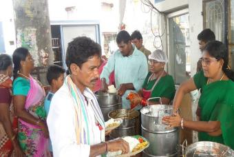 Serving meals to cyclone affected people