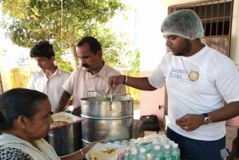 Flood-affected people being served with fresh food