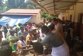 Flood affected people enjoying the food