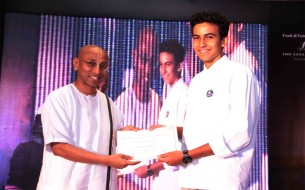 Shri Chanchalapathi Dasa, Vice-Chairman certifies Shivant Malkani as Akshaya Patra's first Youth Ambassador