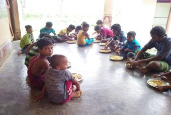 Children sit together for lunch
