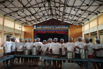 Akshaya Patra team serving food in Edathua