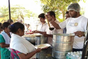 People in Edathua being served with chapati, curry, and pulao
