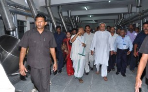 CM Patnaik is taken on a tour of the 3rd centralised kitchen unit in Odisha