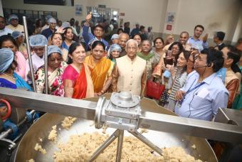 Dignitaries on a tour of the kitchen facilities