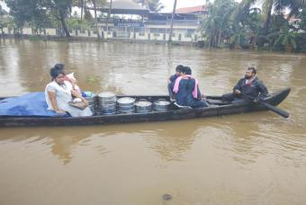 Packaged food being transported by boat across the flood affected regions