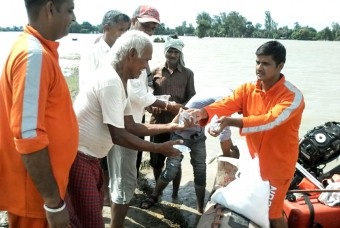 About 70 villagers, stuck in the villages which are submerged in flood water