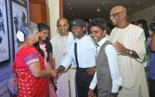Chief Guest, Mrs. Sudha Murty (left), exchanging greetings with the three Akshaya Patra beneficiaries at the launch event