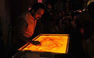 Award winning sand artist, Mr. Raghavendra Hegde showcasing the story of The Akshaya Patra Foundation