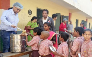 The kids of Government Higher Primary School, Konunkunte, Bengaluru, queue up eagerly for their meal, served by Mr Bansal