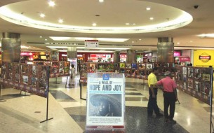 An eye level view of the 'Wall of Hope and Joy Exhibition' at Mantri Square.
