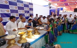 CM and dignitaries serve food to Akshaya Patra beneficiaries