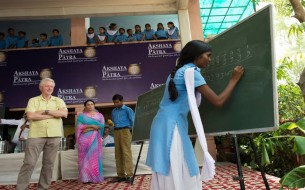 Children demonstrate their mathematical skill. Photo credit: Clinton Foundation/ Barbara Kinney