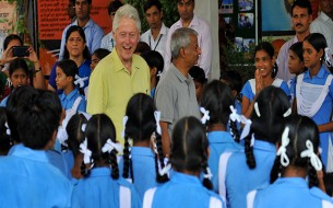 Clinton shares a light moment with the children. Photo credit: Clinton Foundation/ Barbara Kinney