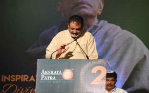 Shri Mohandas Pai, Independent Trustee of Akshaya Patra, speaks to the gathering