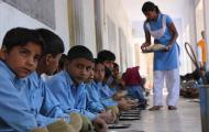 Children in school eating free meal