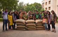 students-of-NIFT-gandhinagar-posing-beside-bags-of-dal
